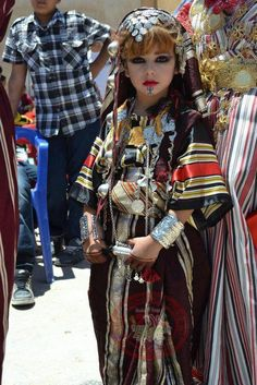 Africa | Young girl dressed in folklore costume.  Libya | ©unknown, no details provided at the source.
