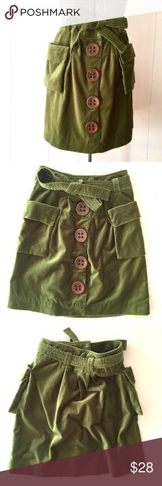 "Anthropologie Elevenses Grass Green Skirt // 0 Fantastic Anthropologie Elevenses big button skirt. Grass green velvet with oversized brown buttons. Tie waist with hidden snap closure. Very good condition. Shell 100% cotton, lining 100% polyester. Size 0. 21"" long. 13 1/2"" waist flat. Anthropologie Skirts"