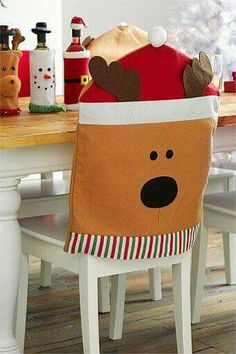 Why not make the Christmas dinner table look that extra bit special with some Christmas-themed dining chair covers. Felt Christmas Decorations, Christmas Wood, Christmas Stockings, Christmas Design, Dining Room Chair Covers, Dining Chair Slipcovers, Christmas Chair Covers, Deco Table, Christen