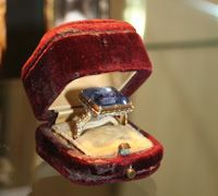 """A Large sapphire ring, said to have belonged to Mary, Queen of Scots. It has been in the Hamilton Collection since 1587. The inscription on the back of the bezel reads, in 17th-century writing, """"Sent by Queen Mary of Scotland at her death"""". On the hoop are the words, """"to John, Mar Hamilton"""". The 1st Marquis of Hamilton had been one of Mary's staunchest supporters. He went into exile after her defeat in 1568, but in 1585, James VI welcomed him back, praising his fidelity"""