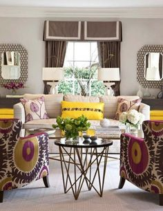 Purple yellow and grey. Love the chairs.