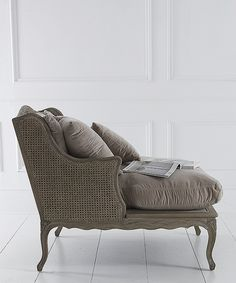 Chaise Reveuse  This gorgeous Bergere style chair with feather filled cushions covered in soft and sumptuous taupe velvet, has traditional double caned back and sides in a washed oak finish. Its name - Chaise Reveuse, means The Dreamer's Chair and is the perfect place to curl up and dream.  91h x 95w x 105d cm.    £1,395.00