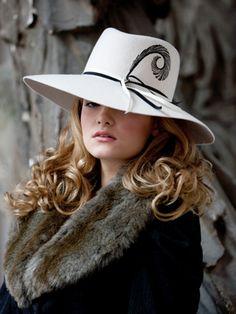 white hat, fur collar