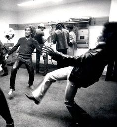 Bob Marley and Jimi Hendrix fooling around with a soccer ball backstage.