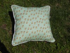 A personal favorite from my Etsy shop https://www.etsy.com/listing/235806537/little-arrows-pillow-green-and