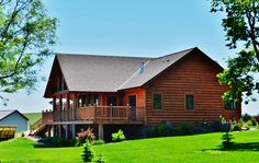 Hackel Construction Inc. acted as general manager in the construction of this log home and framed, finished, and built the poolside deck.