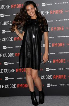 Giulia Anchisi wears a leather dress at the Sole Cuore Amore photocall in Rome, Italy