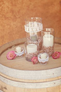 A Rustic Chic Desert Wedding. Cactus center pieces with natural colors.