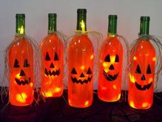 Creative Ways To Use Wine Bottles As Halloween DecorBe creative and decorate your house or porch with some scary decorations made from bottle wines.It's very easy to do and cheap, also. Not to mention they are pretty funny-spooky Halloween accessories. Fall Wine Bottles, Halloween Wine Bottles, Christmas Wine Bottles, Wine Bottle Art, Painted Wine Bottles, Lighted Wine Bottles, Bottle Lights, Wine Bottle Lighting, Decorate Wine Bottles
