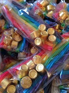 "March Staff in-box gift: Twizzler rainbows with ""gold"" Rolos. Tied off with a cute ""Happy St. Patrick's Day"" tag!"