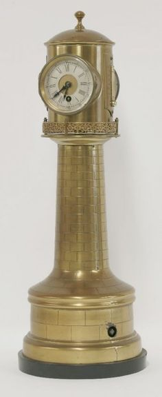 A Victorian brass English lighthouse clock, the revolving top with clock, barometer and two thermometers on a tapering column, the base with clockwork mechanism, Unusual Clocks, Cool Clocks, Tick Tock Clock, Locomotive, Time Stood Still, Antique Clocks, Lighthouse, Vintage Antiques, Hickory Dickory