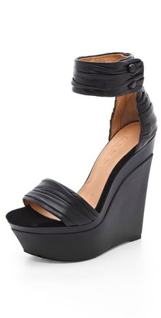 love these high heeled L.A.M.B. wedges! the ankle strap helps with stability!
