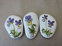 Stones With Painted Flowers And Leaves Stock Photo - Image: 53161742