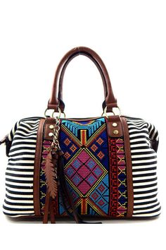 Black and white stripes, intricate beaded aztec detailing. Dimensions - 14.5L x 5.5W x 9H, 7 drop handles Optional adjustable shoulder strap Canvas and faux