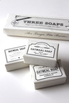 Set of three all natural milled bath soaps with apothecary labels.