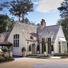I'm so glad one of my #followerfriends turned me onto Ben Shepard and Darla Davis! They do #incredible #work down in #birmingham ♂️I #love #this #perfectlysized #englishcountry #inspired #customhome ♂️it's mostly just one-room deep, so there's #tonsoflight ♂️ And that #cedar #roof? And the #paintedbrick What do you #think about this #style? ☝#like above and #comment below