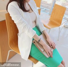 Business fashion attire outfit. Love the color of the skirt.