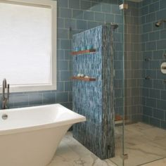 like this floating wall with shelves to separate vanity and shower