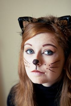 I think I'll be a cat for Halloween. I will wear all black peels and paint my face . I think I'll be a cat for Halloween. I will wear all black peels and paint my face like this. Cat Face Halloween, Halloween Bebes, Halloween Costumes For Work, Cat Costumes, Halloween Make Up, Costume Ideas, Kitty Costume, Bear Costume, Family Costumes