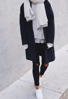 Winter. Black coat, striped shirt, grey scarf, black skinny