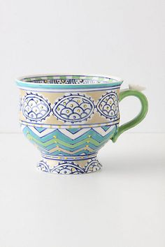it would be cool have an assortment of mismatched mugs in bright colors and patterns