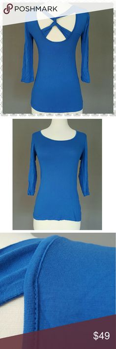 """BOSTON PROPER Top BRAND NEW W/out tags, on line order, they do not attach tags. Beautiful electric blue Boston Proper top with a cool cris cross detail on the back. Size XS, runs big in this brand, will fit S. This top has a lot of stretch. Listed as S due to fit.  Length 24.5"""" shoulder to bottom  Material 95% viscose, 5% spandex Lots of stretch Boston Proper Tops Tees - Long Sleeve"""
