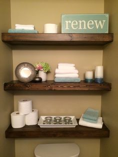 Floating wood shelves & decor for a small bathroom