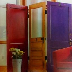 A room divider made with repurposed old doors! - Dishfunctional Designs: New Takes On Old Doors: Salvaged Doors Repurposed Room Divider Doors, Diy Room Divider, Room Dividers, Divider Ideas, Divider Screen, Screen Doors, Divider Cabinet, Divider Design, Repurposed Furniture