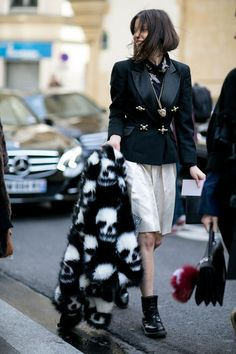 Street Style Snaps From Paris Fashion Week Fall 2015 - White, pleated wide-leg  bermuda shorts worn with an embellished black blazer, + a statement-making skull patterned black and white fur coat