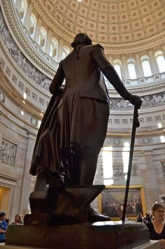 George Washington's statue watching the citizens who have come to visit the rotunda, Washington DC
