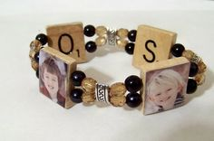 Made from Scrabble pieces- this is perfect for me...because me and the girls love to play scrabble together.