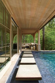 Modern Pool - 17 Sparkling Pools - Southernliving. Concrete pavers set in the saline pool provide a path from the house to the porch and allow the water's edge to hug the building.