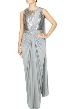 This saree gown is in lycra fabric with silver grey bodice. This saree gown is available in pre drapped. This product will be shipped to you after 3-4 weeks from the date of order placed.