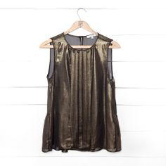 Add a little shimmer to your wardrobe with this metallic black-gold sleeveless top.