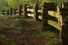 Wood and stone fence in early morning sunlight