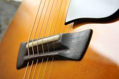 string-through acoustic guitar bridge