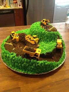 """Construction cake with """"risers"""" and holes dug into the surface of it. The downside is that is A LOT of grass to pipe. Construction Party Cakes, Construction Birthday Parties, 3rd Birthday Cakes, Boy Birthday Parties, Birthday Ideas, 4th Birthday, Digger Cake, Digger Birthday, Cakes For Boys"""
