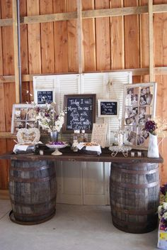 chic rustic wedding bride and groom table decoration ideas-- old door for table with old wine barrels. Love the glass windows with the pictures displayed on them