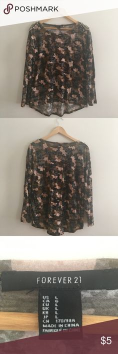 """✨FLASH SALE✨Spiked Camo Pattern Long Sleeve Shirt A camo patterned long sleeve shirt with spike detailing on the shoulder. Some of the spikes are a bit loose. The """"silver"""" on some of the spikes is a bit worn off. Shirt from Forever21 ❤. High low shirt. Forever 21 Tops Tees - Long Sleeve"""