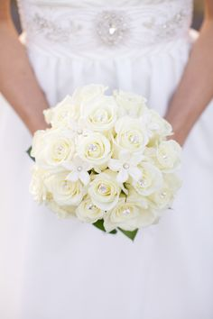 wedding flowers - white roses and stephanotis with pearl and diamond accents   www.katemagee.com
