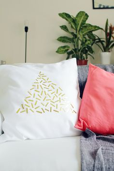 Gold foil confetti cushion DIY at Design*Sponge by Fall for DIY