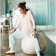 Slowly lower yourself onto the ball with your partner's help. Sit with knees apart, feet flat on the floor. Rock back and forth or side to side until you find a soothing rhythm. (If you're 5 feet 2 inches to 5 feet 7 inches tall, use a 55 cm ball; if you're 5 feet 7 inches or taller, opt for a 65 cm.) What it does: Opens the pelvis, helping the baby descend through the birth canal.