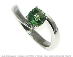 Platinum twist engagement ring with green tourmaline. ~ Harriet Kelsall Jewellery Design