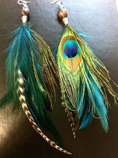 Peacock feather earrings.  Using this pin to see the color options I have in decorating a room with peacock-colored accents!