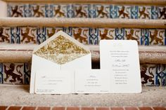 Elegant gold, black and cream wedding invitation set | Photo: Sara Kauss Photography