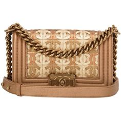 Preowned Chanel Dark Gold Metallic Cc Embellished Lambskin Small Boy... (9,910 CAD) ❤ liked on Polyvore featuring bags, handbags, multiple, lambskin handbag, embellished purses, preowned handbags, lambskin leather handbags und gold metallic purse