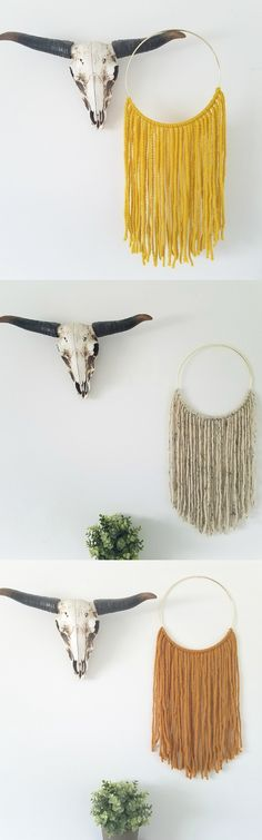 these yarn wall hangings are so creative! and the colors are perfection.