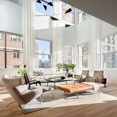Amazing architectural design - room full of windows and tall window treatments. Shigeru Ban's Cast Iron House model apartment decorated by Brad Ford ID. Photography by Scott Frances.