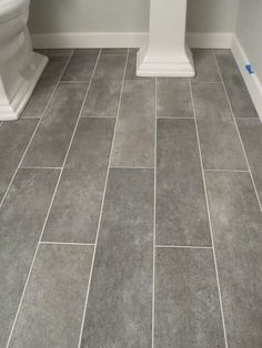 "gray plank ceramic tiles - very similar to new kitchen floor except there's a little more variety in the ""grain"" look to ours; using dark gray grout...can't wait until it's all done!"