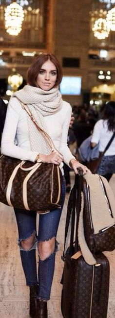 Taking pretentiousness to a whole new level. Not only is she wearing vile torn jeans, she's swamped in tacky Louis Vuitton luggage, to boot! Nothing like advertising your wealth and lack of taste in one fell swoop.